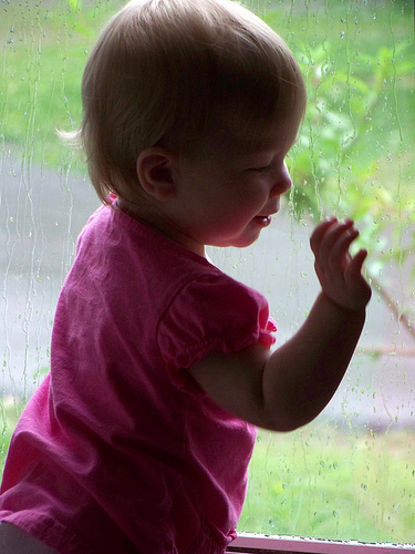 baby looking out in rain