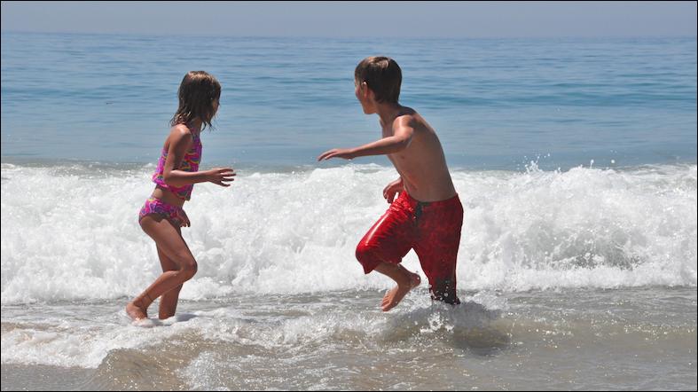 kids playing in waves laguna beach ca
