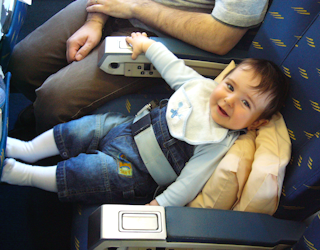 baby in seat airplane fp