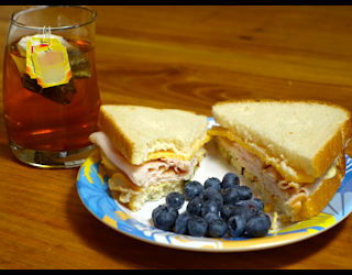 lunch sandwich on plate with iced tea fp