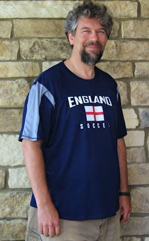 Dave Taylor wearing an England Soccer jersey