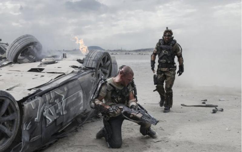 "XX (Copley) stalks an injured Max (Damon) in ""Elysium"""