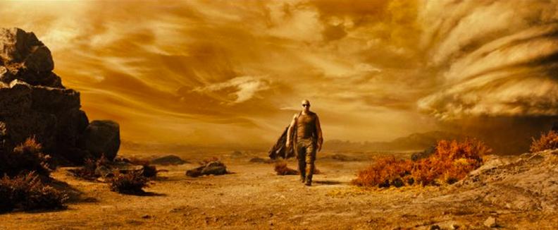 Riddick (Vin Diesel) wanders a dusty planet
