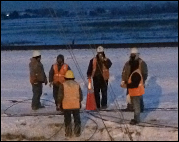 xcel energy crew hard at a work in the freezing snow