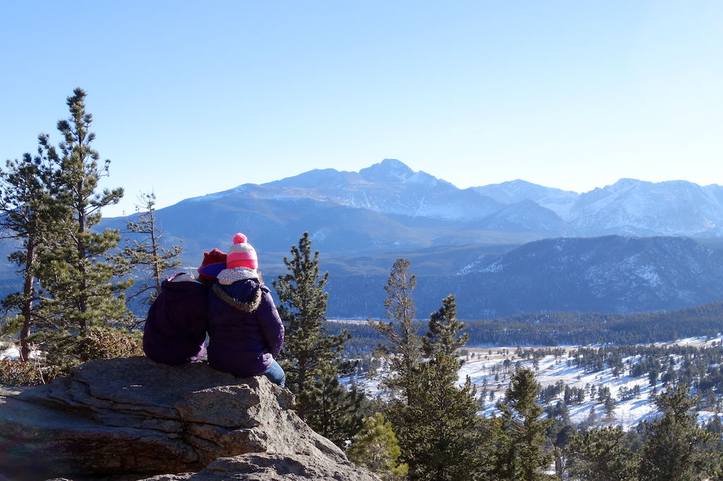 Two girls gazing at the distant mountains, rmnp