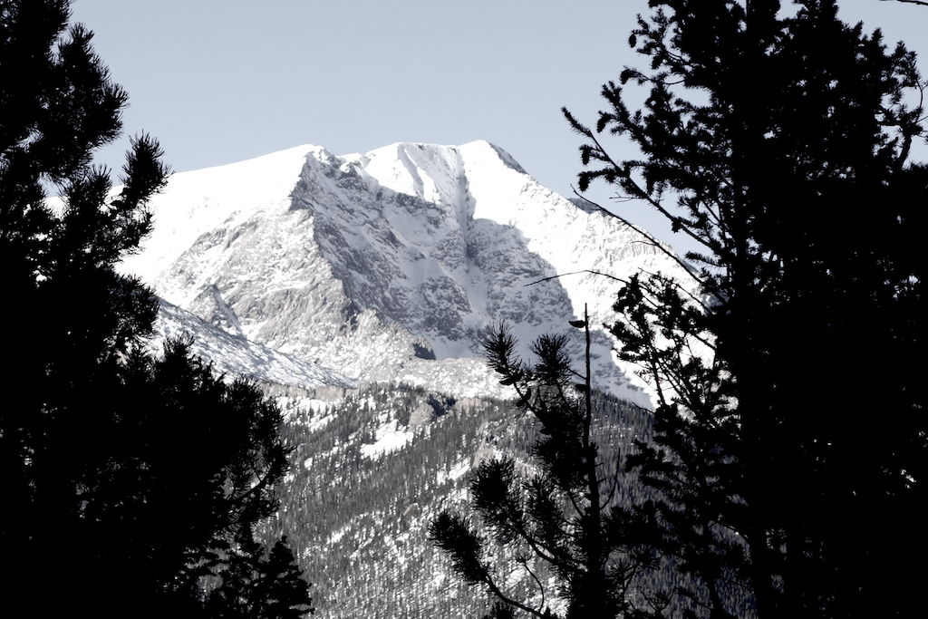 rocky mountain peak covered in snow