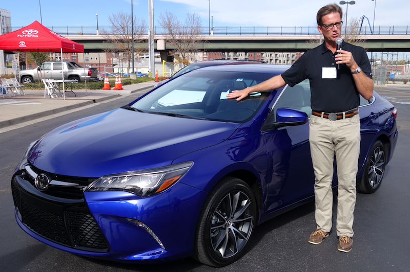 david lee, marketing team, toyota motors usa, in front of 2015 camry se