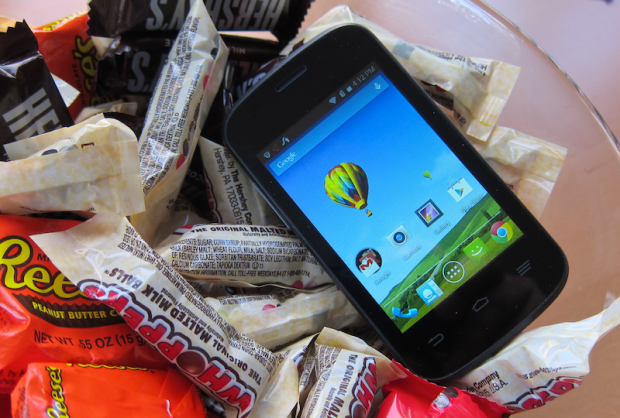 cellphone in a bowl of candy