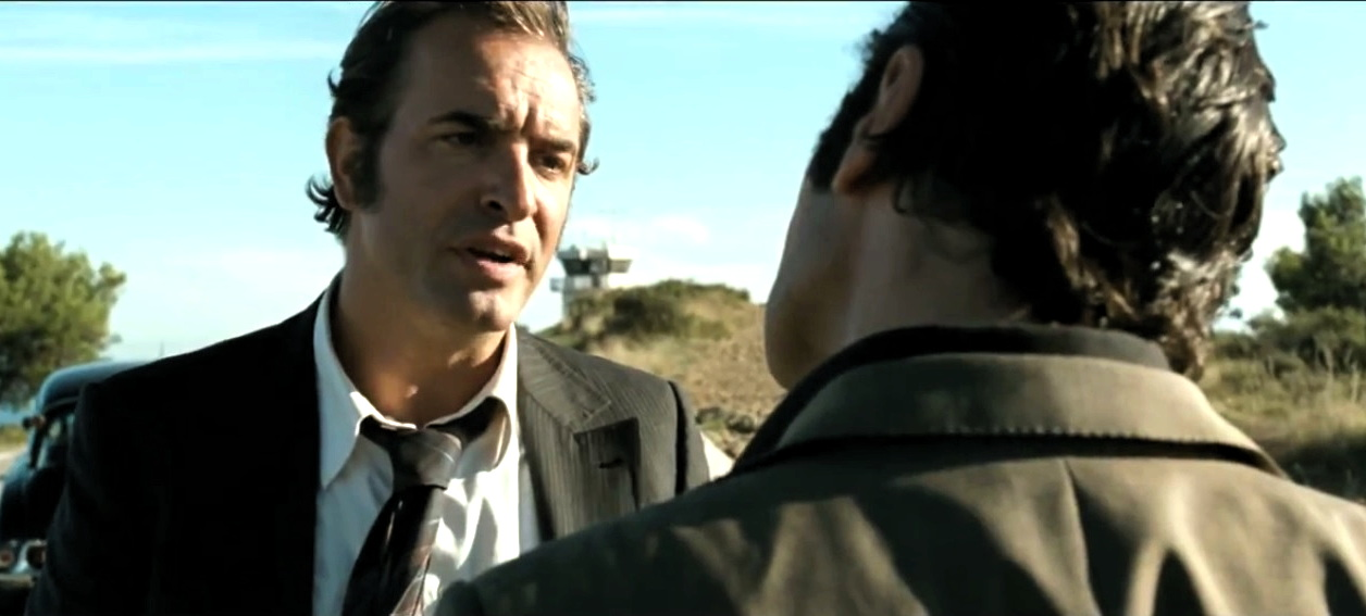 "Pierre Michel (Jean Dujardin) has a conversation with Gaëtan Zampa (Gilles Lellouche) in ""The Connection"""
