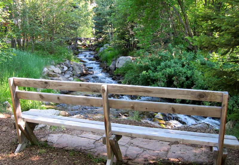 bench on edge of mountain stream, sundance resort