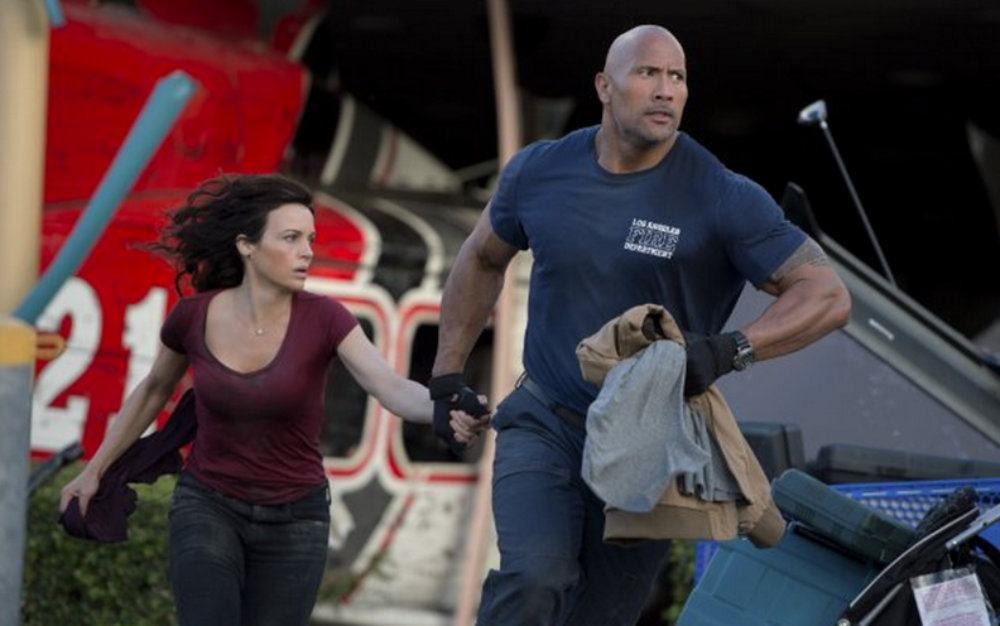 "Chief Ray (Dwayne Johnson) and wife Emma (Carla Gugino), from ""San Andreas"""