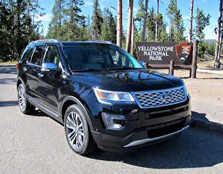 2016 ford explorer platinum in front of yellowstone national park sign
