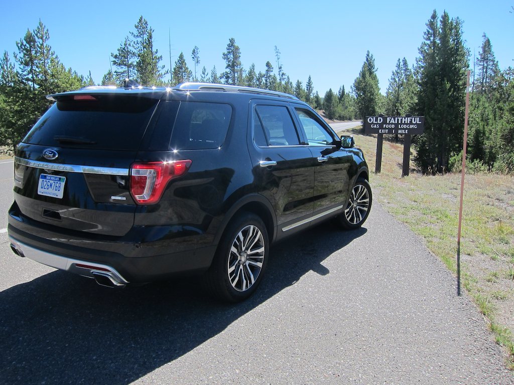 2016 ford explorer in front of old faithful sign, yellowstone