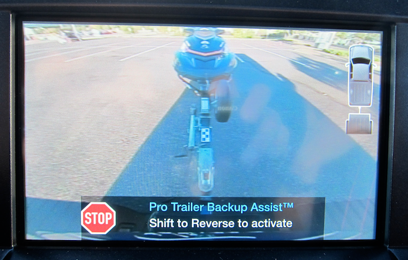 trailer backup assist, console view with sticker on trailer