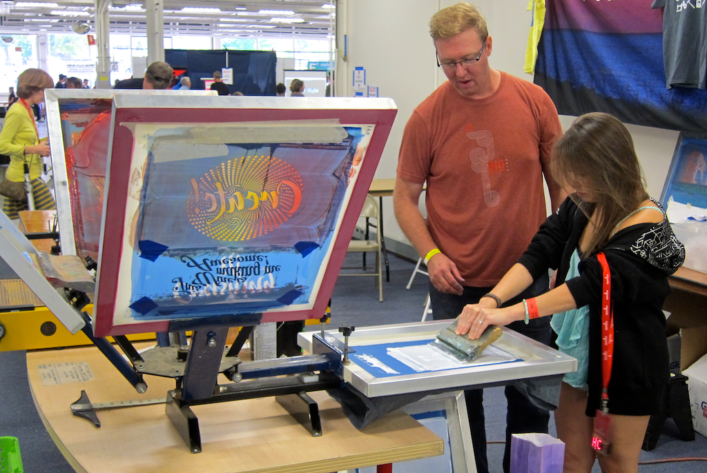 screen printing a t-shirt at the noco makers faire