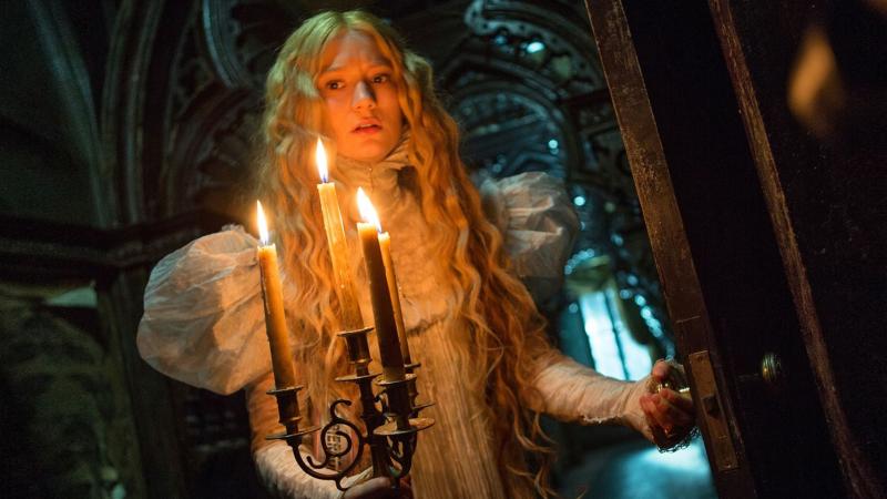 "Edith (Mia Wasikowska) explores the Sharpe mansion, ""Crimson Peak"""