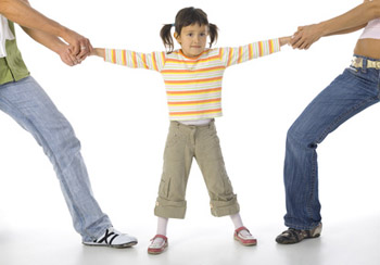 parents pulling child in opposing directions