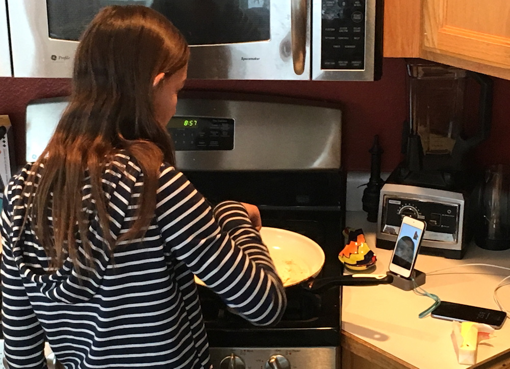 girl cooking while on apple facetime