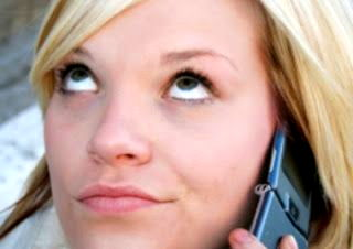 moody teen rolling her eyes, on cellphone