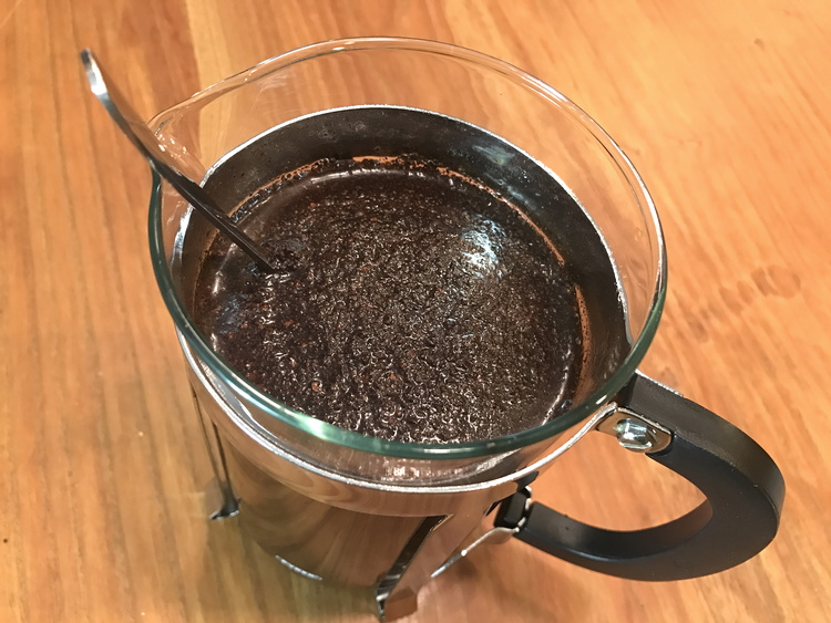 ground coffee floating on water, french press, cold brew