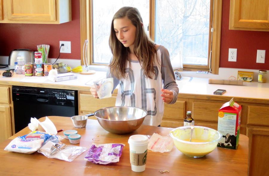 girl cooking in kitchen baking