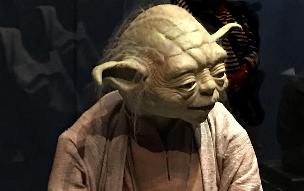 yoda figure and costume, star wars