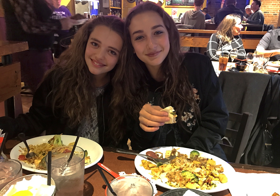 two girls enjoying dinner at bd's mongolian bbq, denver co