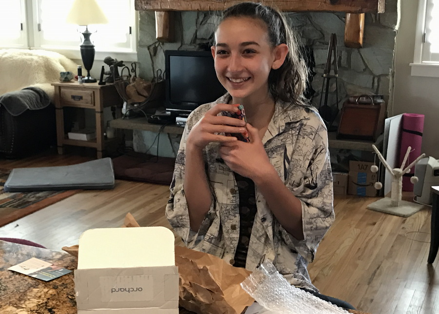 delighted girl with new smartphone iphone