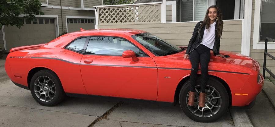 girl sitting on 2017 dodge challenger gt go mango