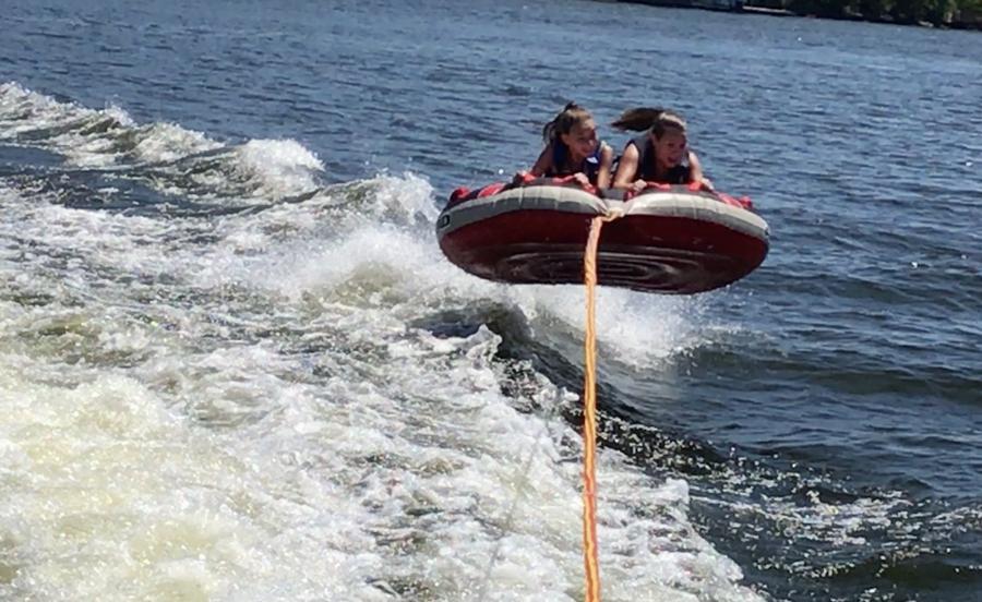 girls tubing airborne air lake water