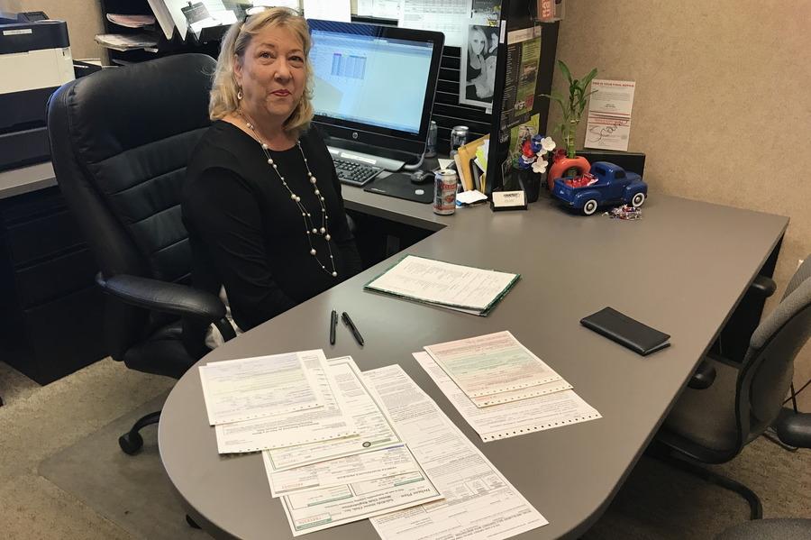 signing car loan paperwork, mazda