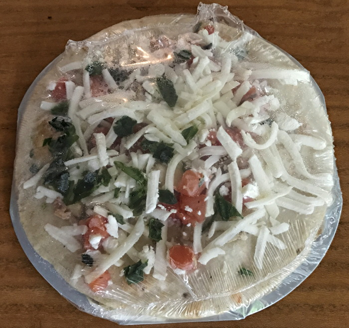 frozen pizza wrapped in plastic