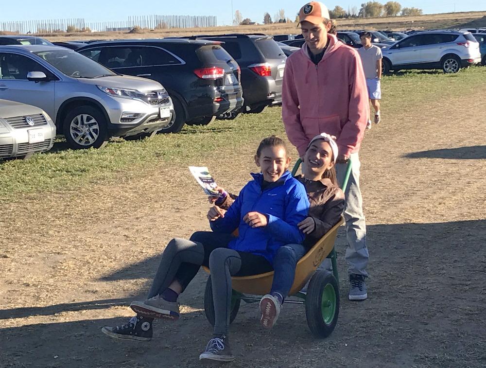 kids in wheelbarrow