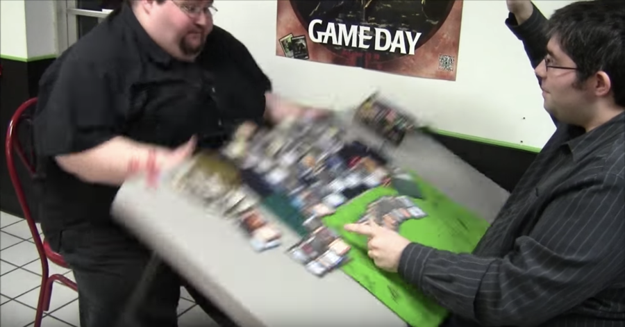 man throws gaming table over, angry frustrated mad