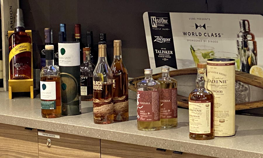four whiskeys - whiskey tasting samples - total wine
