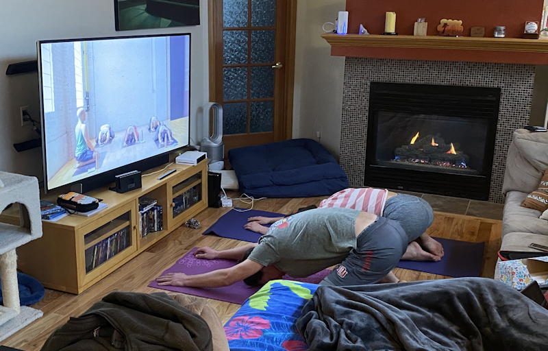 kids doing yoga in front of television coronavirus quarantine home
