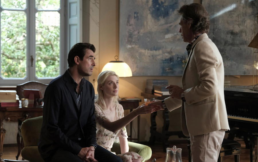 "Figueras (Claes Bang), Hollis (Elizabeth Debicki) and Cassidy (Mick Jagger), from ""The Burnt Orange Heresy"""