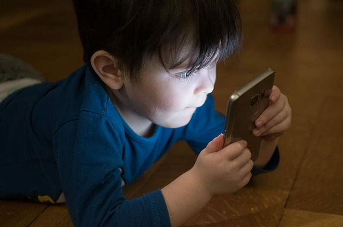 boy obsessed with smartphone