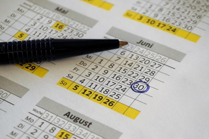 pen on calendar planning