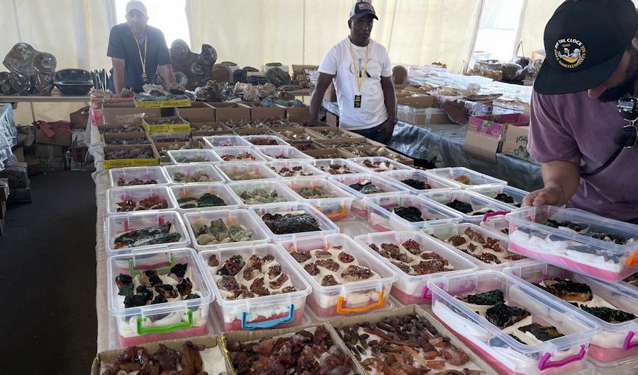 denver mineral, fossil, gem and mineral show denver 2021 - raw gems minerals in tent