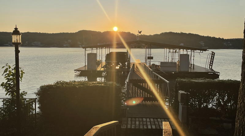 lake of the ozarks sunset over dock boats