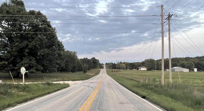 rural road stretching straight to horizon